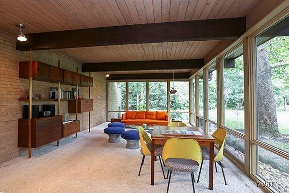 mid-century modern dream home! #mcm orange couch, walnut wall unit