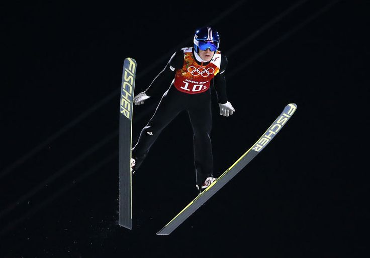 DAY 11:  Jurij Tepes of Slovenia competes during Ski Jumping Men's Team Large Hill http://sports.yahoo.com/olympics