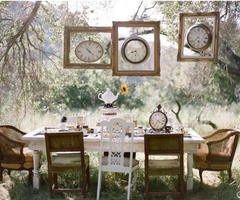 Alice in Wonderland, I like that the clocks are in frames and the chairs are mixed. very chic