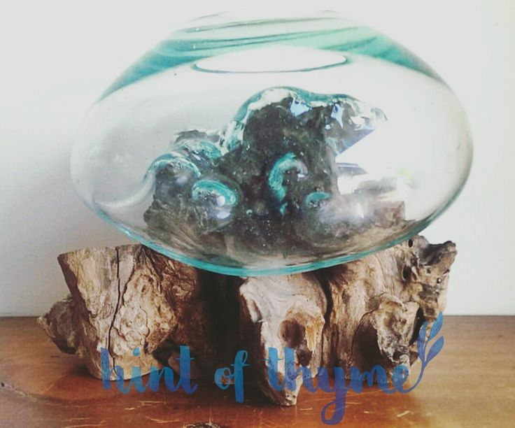 Handmade blown glass bowl on a natural teak wooden base, D size.Each item is unique as they are made from natural wood.