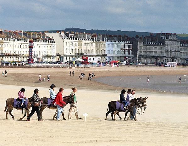 Weymouth Beach, Weymouth, Dorset ...kids having fun on the donkey rides
