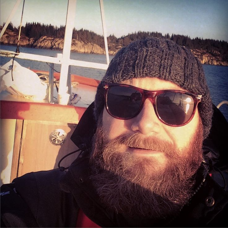 I'm on a boat! With my sunglasses, knitted hat and big beard!