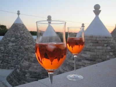 "In Puglia, there are traditional dry stone huts with conical roofs known as ""trulli."" Most of them are found in and around the Alberobello which is a World Heritage Site. What a backdrop for sunset drinks at Masseria Gelso Bianco."