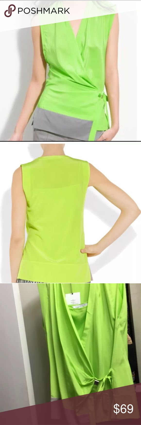 """NWT DVF Diane Von Furstenberg Aiko Silk Wrap Top This is a NEW With Tags DVF- Diane Von Furstenberg sleeveless Aiko Wrap Top in a size 12. 100% Authentic Designer piece! The vibrant neon color makes it a resort/Summer standout!  It is made of silk and features a crossover V neck. Logo DVF tie at side- wrap style and contrast grey trim at front.  Sleeveless. Separate Camisole lining.  Retail price: $265 * 27"""" long, measured from shoulder. * Fabrication: Woven silk. * 100% silk. Diane von…"""
