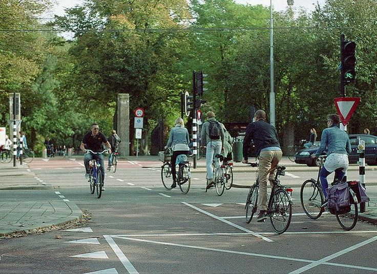 Bike-friendly junction in Amsterdam. Click image to tweet via Cycling Professor and visit the slowottawa.ca boards >> https://www.pinterest.com/slowottawa/boards