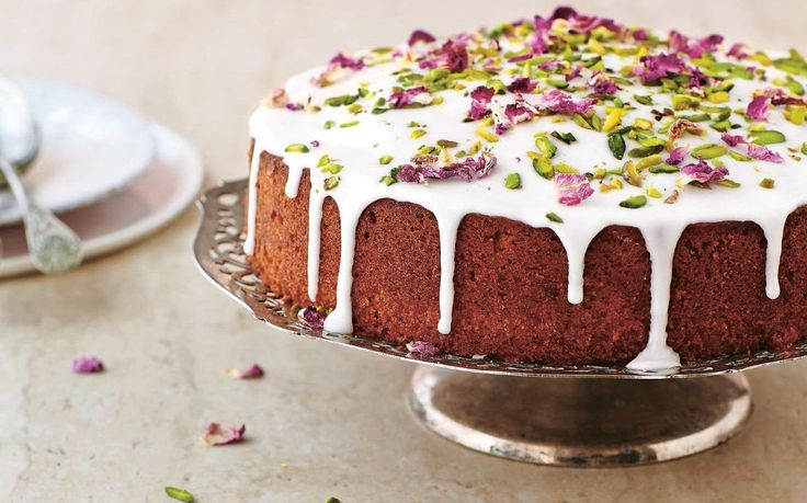 This enchanting cake reminds me of a Persian garden in the late spring, adorned with the floral scent of rose water and citrus, and decorated with bright green pistachios.