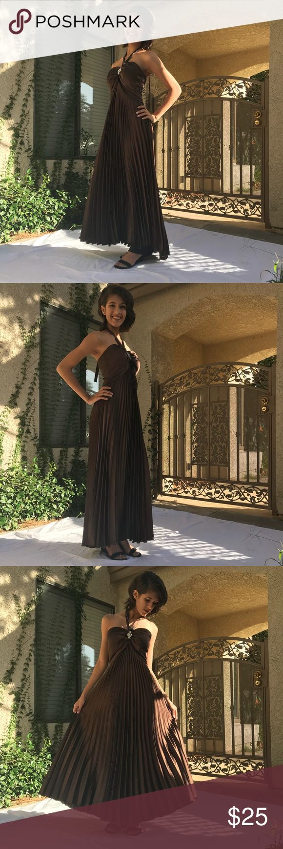 PROM DRESS! Beautiful satin brown dress, perfect and elegant for that special night dancing the night away! Spin and look gorgeous with the mermaid fold of the dress! Pairing with black and silver heels pops the outfit! Group USA Dresses Prom