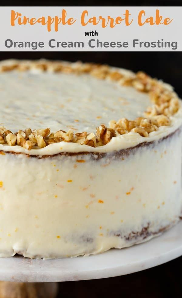 This Pineapple Carrot Cake with Orange Cream Cheese Frosting recipe is perfect for an Easter party! #carrot #cake #pineapple #dessert via @introvertbaker