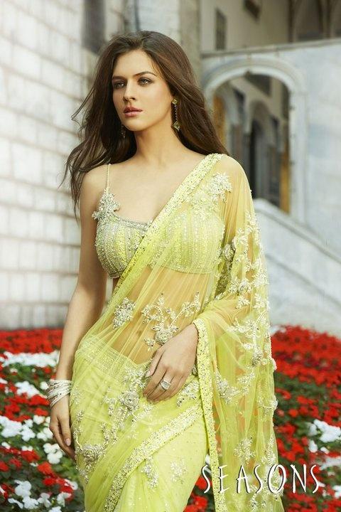 Yellow. It's so beautiful I love there collection ♥  Hindu / indian bride Wear saree, lehenga, choli from seasonsindia. the model is Neha Dalvi or Maria Sokolovski