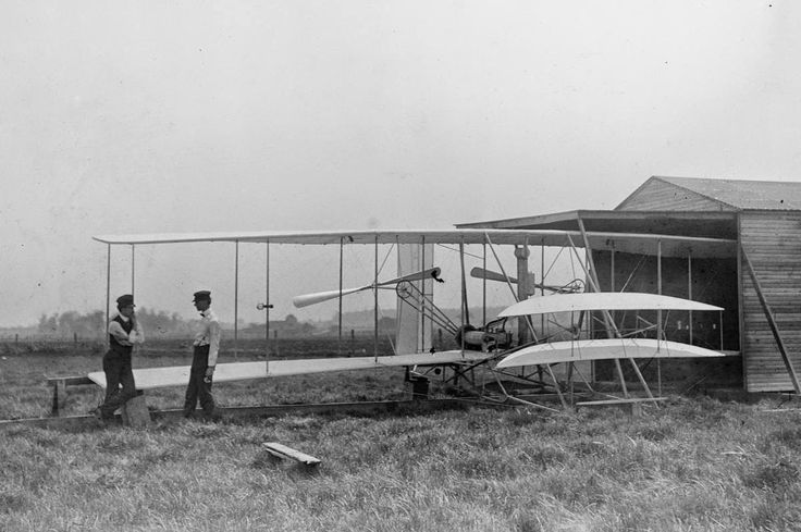 Wilbur and Orville Wright with their second powered machine on Huffman Prairie, near Dayton, Ohio, in May of 1904.