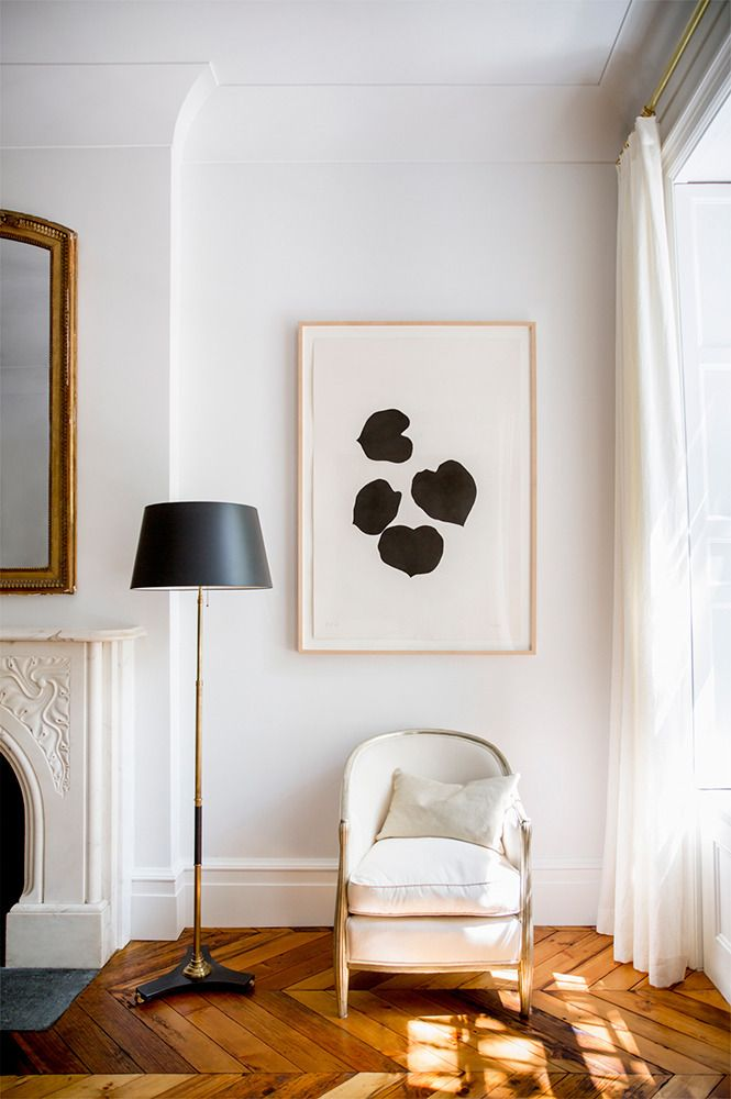 An Ellsworth Kelly canvas adds graphic definition to a quiet corner of the living room