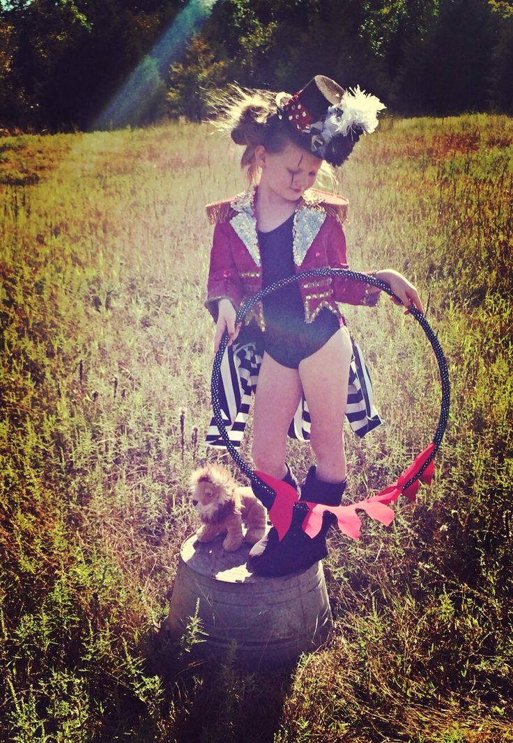 Ringmaster / lion tamer costume!! My pickle is the cutest!