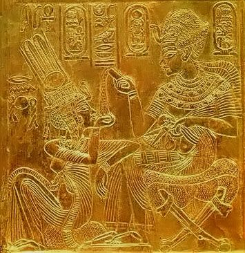 Tutankamun pouring perfume oil onto the waiting hand of his queen Ankhesenamun, as shown on the gilded side of his Nekhbet shrine.