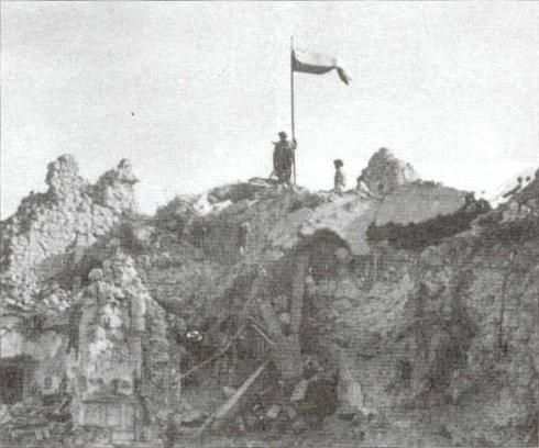 Polish soldiers of 2nd Polish Corp, raise Polish Flag atop Monte Cassino