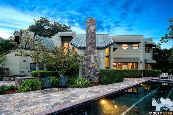 For sale: $2,695,000. Set amongst the oaks, at the top of a private Happy Valley lane shared by only six homes, stands this gated residence showcasing many recent renovations (2015/2016), amazing natural light through stunning walls of glass, open and inviting living areas paired with private bedroom spaces, and serene valley views from most rooms.  Offering the rare ability to retreat to privacy while remaining part of a true community, the nearly 1-acre property provides a peaceful san...