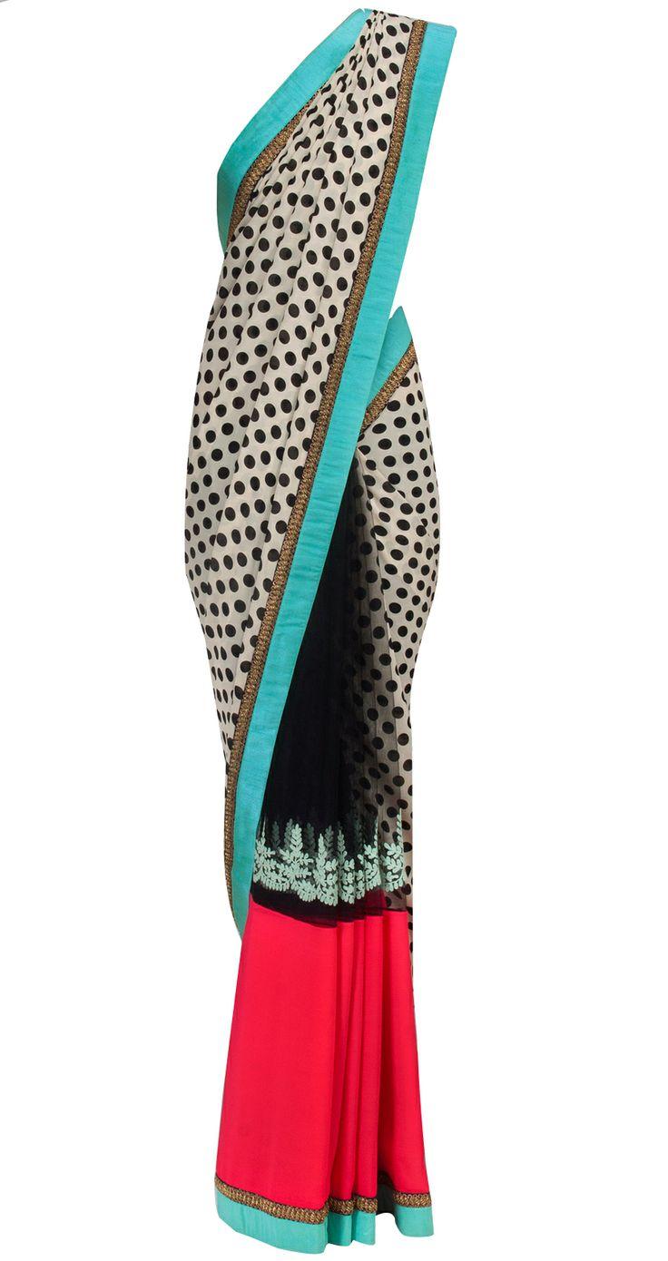 Ivory polka dots net and georgette sari by SABYASACHI. Shop at https://www.perniaspopupshop.com/designers-1/sabyasachi/sabyasachi-20