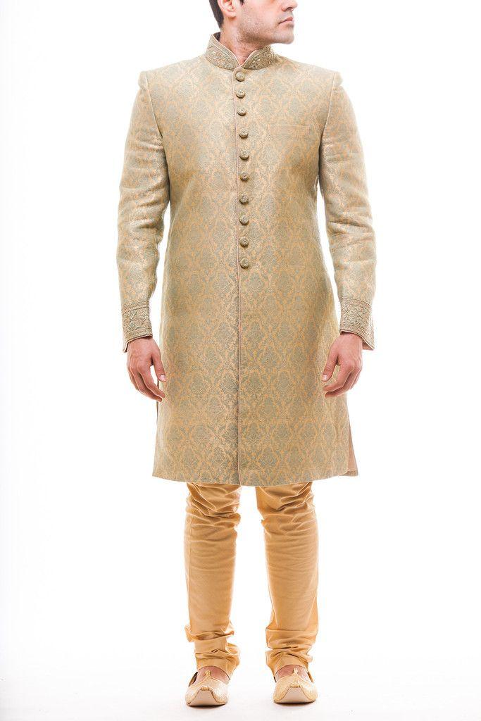 Sage Green Brocade sherwani paired with gold silk churidaar