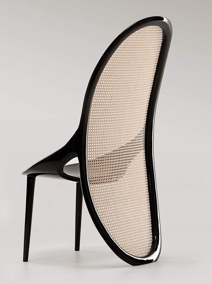Wiener chair designed by Gabriella Asztalos is a curvy, elegant and refined piece of art. The Thonet inspired chair has black lacquered wood structure and Vienna straw. Presented by Luxury Living