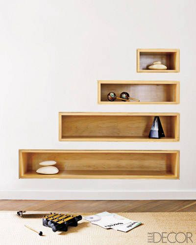 Custom-made recessed shelves under the stairs.