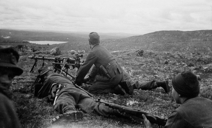 A machine squad of 2/136 Geb.Jag.Rgt during the assault on Hill 122. 30th June, 1941.