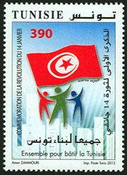 Subject  The first Anniversary of the Revolution of January 14th : Together to build Tunisia  Number  1906  Size  37 x 52 mm  Issue Date  14/01/2012  Number issued  500 000  Serie  Commemorative  Printing process  offset  Value  390 millimes  Drawing  Amor ZAMMOURI