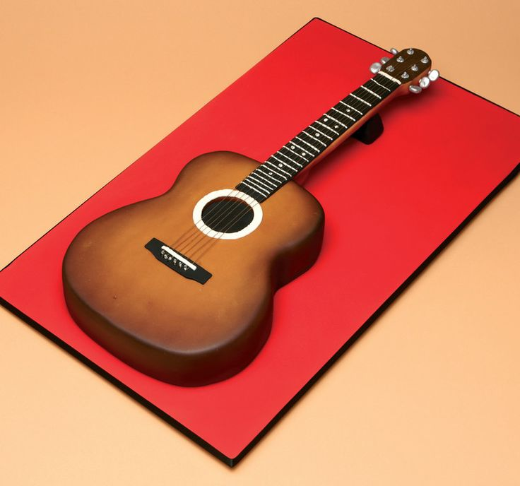 This is the perfect cake for any music lover or budding guitar legend. The design uses an airbrush to build up layers of colour and achieve a realistic, streaked wooden effect.