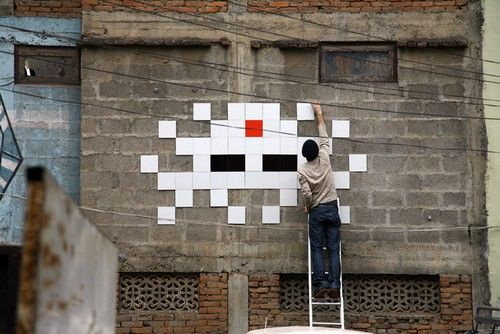 "He is a French artist who imagined characters inspired by the Space Invader game made up of small coloured square tiles that form a mosaic. He does this in cities across the world. Then he documents this work as an ""Invasion"", with books and maps of where to find each invader"