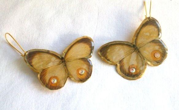 Σκουλαρίκια πεταλούδα απο μπρούντζο με υγρό γυαλί και πέτρες swarovski