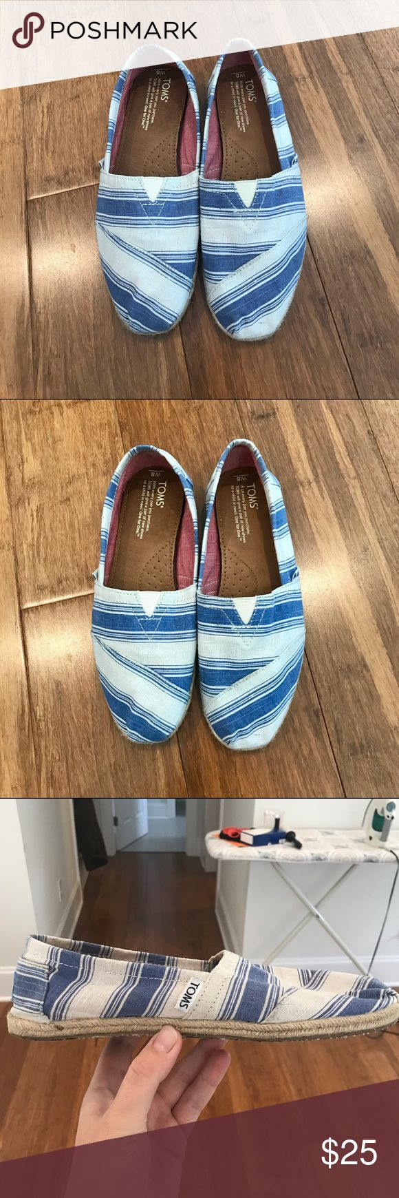 Toms blue and white striped espadrilles So cute for spring/summer! I bought these last year and wore them once, but they're just too small (I usually wear an 8 1/2 but often an 8 in Toms). I appear to have stepped in some kind of tar or something the day that I wore them (no smell but it will not come off), but the bottom of the shoe is the only part that doesn't look brand new! TOMS Shoes Espadrilles