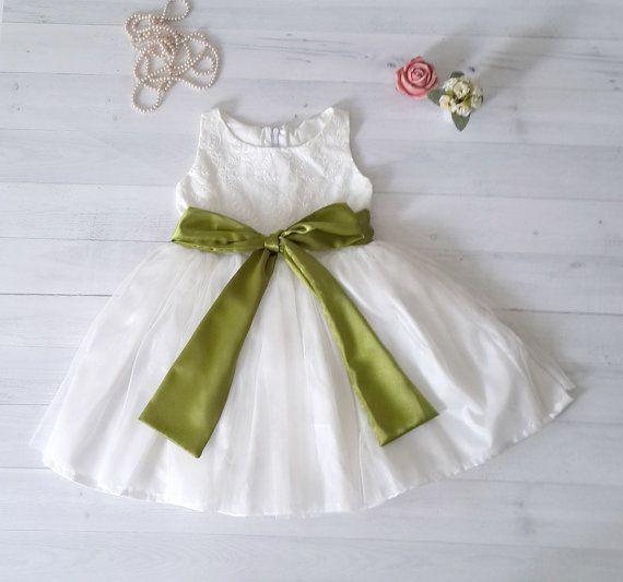 """Ivory white flower girl's dress with 50 sash color to choose from. Please pick your sash color at the last 2 photo and let me know at the """"message to seller"""" section upon check out.    The dress is fully lined with cotton so it will be comfortable to wear. The bodice is off white embroidered cotton in  and the skirt is satin layered with tulle on the outside.  The flower girls will love the twirly dress and is perfect for any other occasion too besides wedding.     Custom Order Size: Please…"""