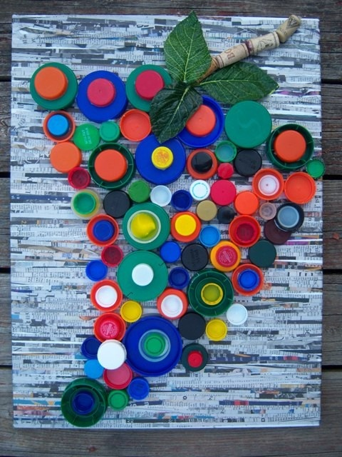 Canvas fitted with strips of newsprint and assortment of plastic bottle caps (sizes, colors,brands, some facing upward, some inward) from Hellray77: SOLD