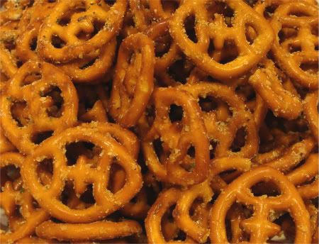 Spicy Pretzels         Ingredients  15 oz Bag of Small Pretzels  6 oz Canola or Vegetable Oil   1 pkg Hidden Valley Ranch Dressing  2 tsp Cayenne Pepper*  1 tsp Garlic Powder  1.5 tsp Lemon Pepper    *You can add another teaspoon of cayenne pepper if you'd like your pretzels REALLY hot.        Directions  Mix together seasoning and oil. Place pretzels in large ziploc bag (the gallon size works for one batch), add seasoning mix, and toss periodically for 12-24 hours before serving