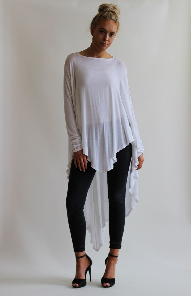 Oversized draped top with long skinny sleeves and peak hem detail. Oversize cutthat drapes from the bust creating a waterfall effect. Cut longer at the back th