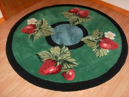 A custom hand made all wool strawberry rug made by KOVRIC RUGS at www.customrugfabrication.com