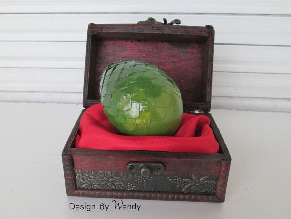 Green dragon egg in wooden chest with dragon story is ideal as geek gift set. This fantasy art set includes one (1) green dragon egg (size L),