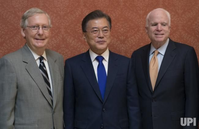 President of South Korea Moon Jae-in poses for a photo with Sen. Mitch McConnell, R-Ky., left and Sen. John McCain, R-AZ, at the U.S.…