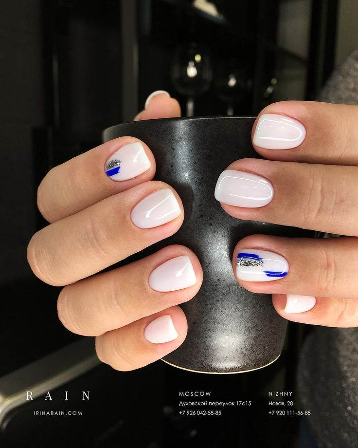 Sheer white and cobalt blue nails