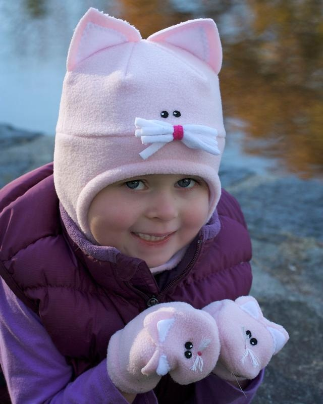 32 Degrees, Original design hand sewn and hand painted adjustable fleece Cat hat and mittens. Hat and mittens are designed for children and young adults. Size range from newborn to adult.  One of a Kind Show Chicago.