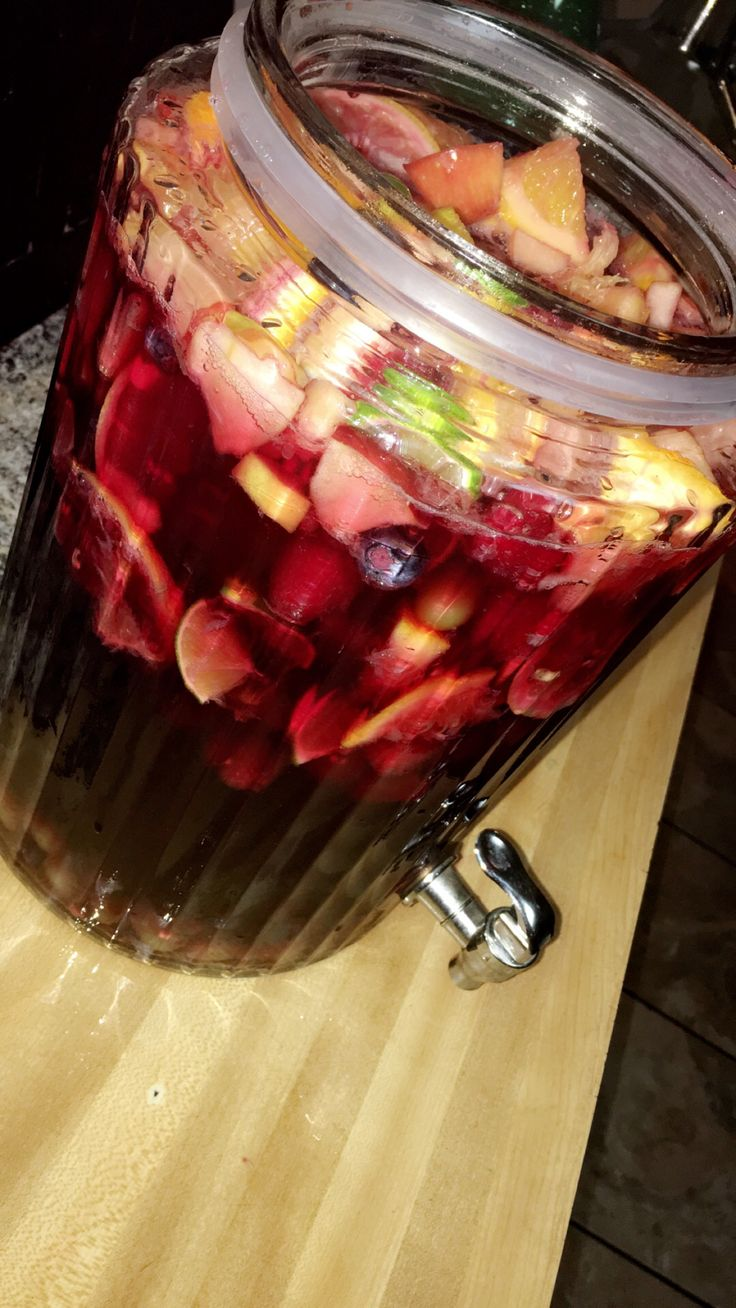 SANGRIA! 1 bottle of Sprite, 1 bottle of Carlo Rossi Sangria wine. Blueberries, Raspberries, Strawberries, Oranges, Lemons, Limes, Navel Red Apples, Green Grapes. 3/4 cup of sugar. Refrigerate for 1 hour. Serve over the rocks.  Taste to Perfection!