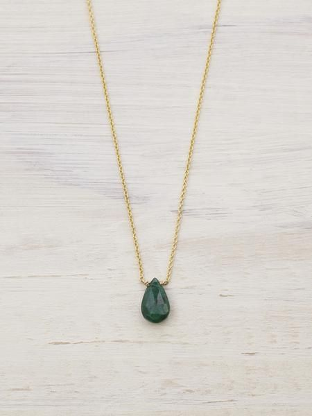 A tiny faceted Emerald teardrop, the gem sacred to the goddess Venus, floats on fine 14K Gold, and adds an elegant aura of earthy love. Handcrafted in NYC. Emeralds are thought to preserve Love as wel