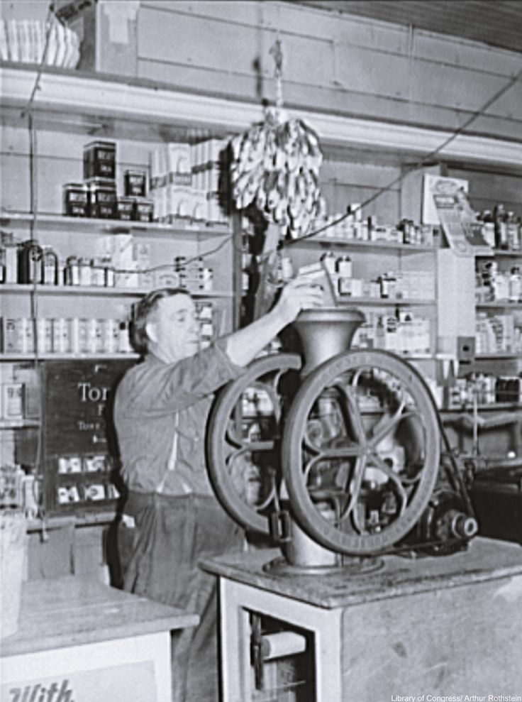 General store in Louisiana, 1939, where coffee is being ground for a customer. Via/ Library of Congress