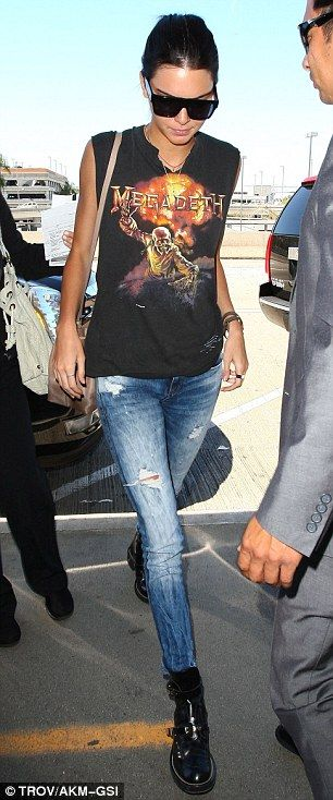 Similar style: Kendall, left, and Kylie Jenner, right, both looked like rocker chicks as they arrived at Los Angeles International Airport via www.dailymail.co.uk