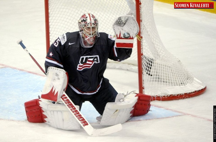 Goalie Jimmy Howard of USA makes a glove save during the game USA vs France, the opener of the 2012 IIHF Ice Hockey World Championships in Helsinki,