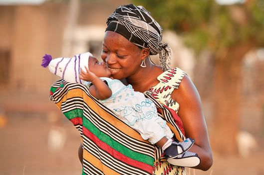 Story of Hope - a book of photographs and stories about motherhood by Ken Duncan supporting World Vision Australia. Must remember this as a gift for my MILs
