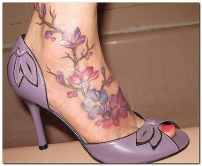 flower foot tattoo design - I would never do this, but between the purple shoes and the purple/pink flowers..I love it