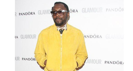 Will.I.Am looks 'dope' in a bold yellow bomber jacket and Ray Ban shades at the Glamour Women of the Year Awards!