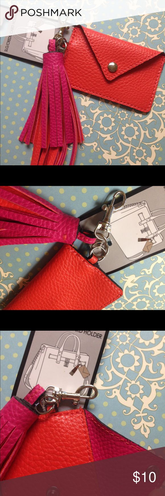 Tassel bag clip charm w/ credit card holder pocket NWT and so cute! Faux leather bag charm with clip, has a tassel charm and a credit card holder with snap closure attached. Color is poppy / pink / orange, see pictures! 💋 Please note that there isn't a key ring attached to this charm / clip, but you could easily add your own (or store your key in the pocket!) 🚫 NO TRADES, 🚭 SMOKE-FREE ITEM, 🐶 DOG-FRIENDLY HOME. 💗💐 Thank you for visiting my Posh closet @leliluv! 🌺😘 All Sales are…