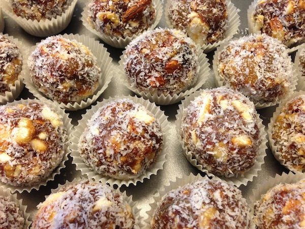 Healthy Raw Energy Balls made with 1 cup each of raw almonds, raw cashews, raw walnuts, dates, pitted, raisin, tahini, unsweetened shredded coconut (see site for instructions)