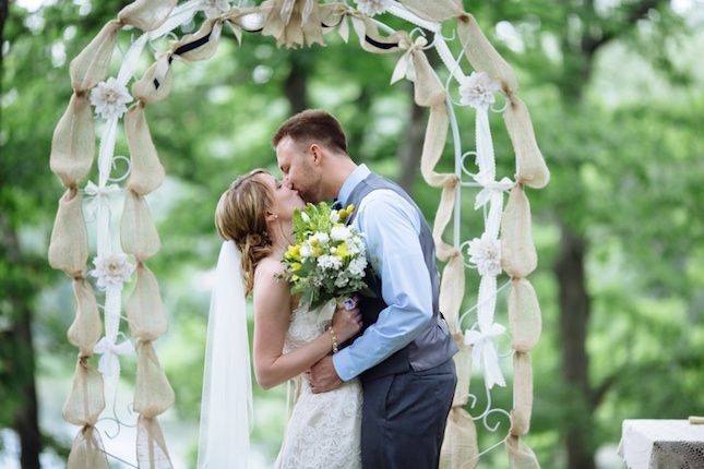 Use burlap, ribbon and flowers to DIY this arch.