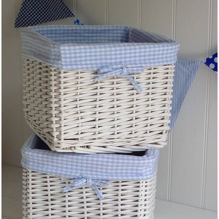 White Storage Baskets Decorated With Blue Gingham Linen